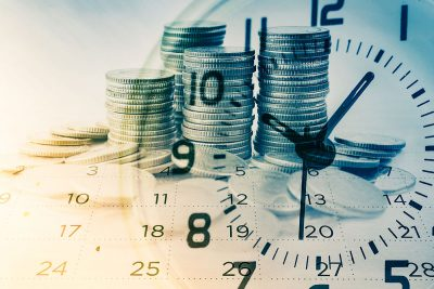 Calendar, clock and money concept. Timing pays off for the early bird ISA investor