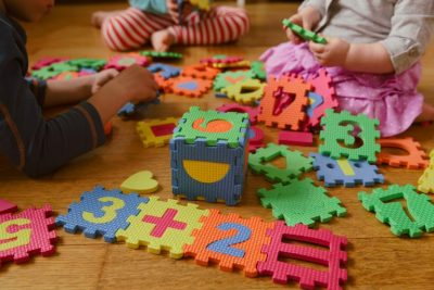 Kids playing with number puzzle, numbers worth knowing in 2020-21