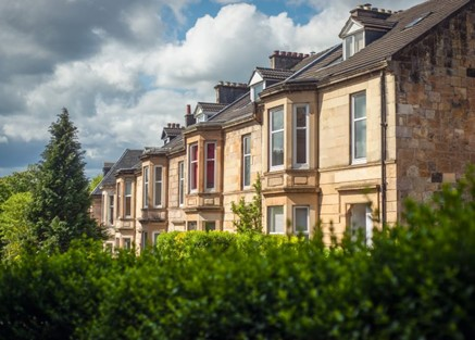 Row of smart Victorian houses in the sunshine, housing market looking sunny and robust